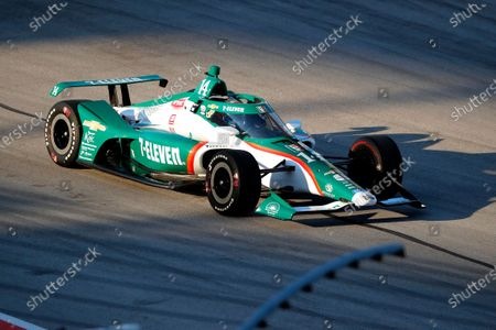 Tony Kanaan exits pit road during an IndyCar auto race at Texas Motor Speedway in Fort Worth, Texas