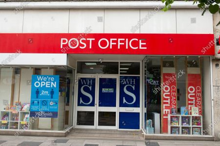 The Post Office at WH Smith in Slough High Street, Berkshire remains open to customers during the coronavirus Covid-19 pandemic lockdown