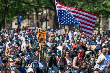 A man waves an upside down American flag as he joins a large group gathered in Union Park to protest the arrest of George Floyd, who later died in police custody, in Chicago, Illinois, USA, 06 June 2020. A bystander's video posted online on 25 May, appeared to show George Floyd, 46, pleading with arresting Minneapolis Police officers that he couldn't breathe as an officer knelt on his neck. The unarmed black man later died in police custody.