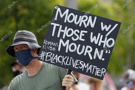 Hand painted message of Scripture is held aloft during a Black Lives Matter rally and march in downtown Jackson, Miss., in response to the recent death of George Floyd in police custody, and to highlight police brutality nationwide including Mississippi