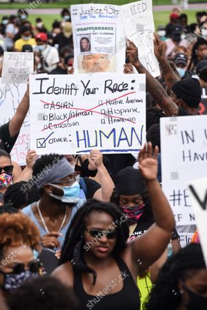 Stock Image of Hundreds of people gather to protest police brutality and the death of George Floyd.
