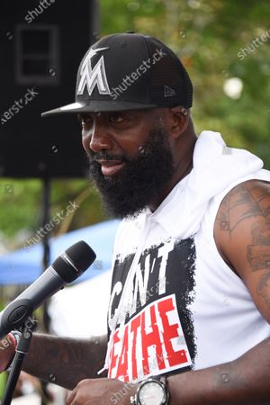 Tracy Martin, father of Trayvon Martin, who lost his life due to racial violence. Tracy Martin speaks to protesters. Hundreds of people gather to protest police brutality and the death of George Floyd.