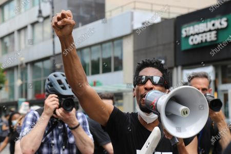 Jon Batiste, bandleader on The Late Show with Stephen Colbert, leads a band in a march, in New York. Demonstrations continue across the United States in protest of racism and police brutality, sparked by the May 25 death of George Floyd in police custody in Minneapolis