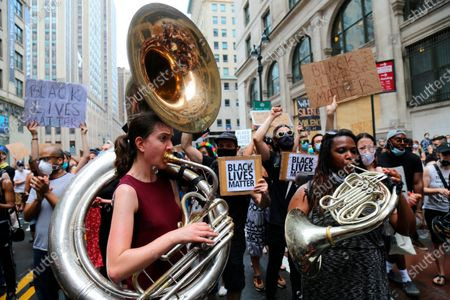 """Members of a band led by Jon Batiste, bandleader on """"The Late Show with Stephen Colbert,"""" march, in New York. Demonstrations continue across the United States in protest of racism and police brutality, sparked by the May 25 death of George Floyd in police custody in Minneapolis"""