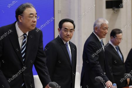 (L-R) Ma Xiaowei, Minister of National Health Commission, Xu Lin, Vice head of the publicity department of the CPC central committee and minister of the the state council information office, Wang Zhigang, Minister of Science and Technology and Ma Zhaoxu, Vice Minister of Foreign Affairs arrive for a press conference by the State Council Information Office to release the White Paper on fighting COVID-19 China in action, in Beijing, China, 07 June 2020.