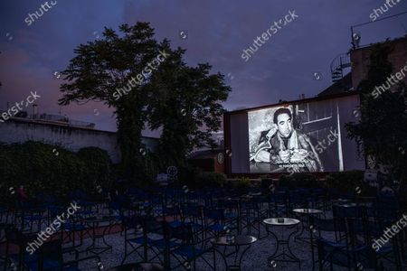 Actor Anthony Quinn is shown on the screen in La Strada, a 1954 Italian drama film directed by Federico Fellini at the Zephyros open-air cinema that specializes in films from past decades in Athens' central Petralona district, on the first day it opened after the easing of Greece's coronavirus lockdown