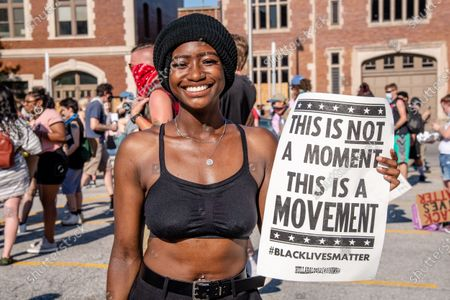 A protester poses for a photo at a 'Sit-in against Racial Injustice' in downtown Indianapolis following demonstrations around the world against police brutality and racial injustice sparked by the death of George Floyd on June, 06, 2020 in Indianapolis, Indiana.