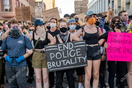 Protestors gather following a 'Sit-in against Racial Injustice' in downtown Indianapolis following demonstrations around the world against police brutality and racial injustice sparked by the death of George Floyd on June, 06, 2020 in Indianapolis, Indiana.