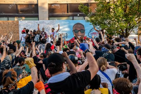Protestors kneel in front of a mural dedicated to Chris Beaty, a protestor who was killed Saturday in downtown Indianapolis. Protestors gathered following demonstrations around the world against police brutality and racial injustice sparked by the death of George Floyd on June, 06, 2020 in Indianapolis, Indiana.