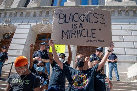 Protestors gather for a 'Sit-in against Racial Injustice' in downtown Indianapolis following demonstrations around the world against police brutality and racial injustice sparked by the death of George Floyd on June, 06, 2020 in Indianapolis, Indiana.
