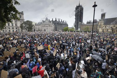 Protesters gather in Parliament Square, central London, during a Black Lives Matter demonstration over the killing of African American George Floyd.