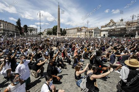 People are on their knees as they attend a demonstration in memory of George Floyd in Piazza del Popolo, Rome, Italy, 07 June 2020. The protesters gather to demonstrate in the wake of the death in police custody of George Floyd in the United States.