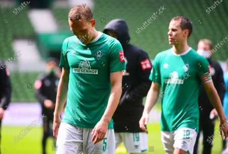 Bremen's Ludwig Augustinsson (L) reacts after the German Bundesliga soccer match between Werder Bremen and VfL Wolfsburg in Bremen, northern Germany, 07 June 2020.