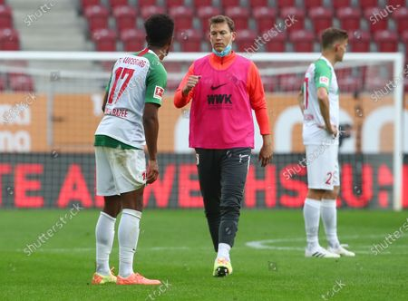 FC Augsburg's Stephan Lichtsteiner and Noah Sarenren Bazee (L) react after the German Bundesliga soccer match between FC Augsburg and FC Cologne in Augsburg, Germany, 07 June 2020.