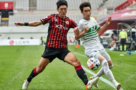 Stock Photo of Kim Nam-chun of FC Seoul competes for the ball with Lee Seung-gi of Jeonbuk Hyundai Motors during 2020 K League 1 match between Jeonbuk Hyundai Motors and FC Seoul at the seoul world cup stadium in Seoul, South Korea, on June 06, 2020.
