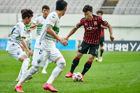 Stock Photo of Go Yo-han of FC Seoul dribbles the ball during 2020 K League 1 match between Jeonbuk Hyundai Motors and FC Seoul at the seoul world cup stadium in Seoul, South Korea, on June 06, 2020.