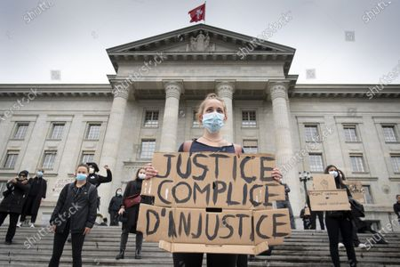 Protesters hold placards in front of the Federal Supreme Court of Switzerland during a Black Lives Matter (BLM) protest, in Lausanne, Switzerland, 07 June 2020. Several thousand people gathered to protest against racism and police violence despite the state of emergency of the coronavirus disease (COVID-19) outbreak and the ban on gatherings of more than 300 people.