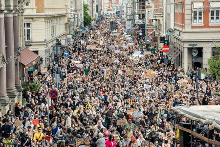 General view of protesters during a Black Lives Matter demonstration in Copenhagen, Denmark, 07 June 2020, in the wake of the killing of George Floyd, an unarmed black man who died after a police officer knelt on his neck in Minneapolis. The demonstration started in front of the US embassy and then continued through the streets of Copenhagen to end up in front of the Parliament building Christiansborg Castle.