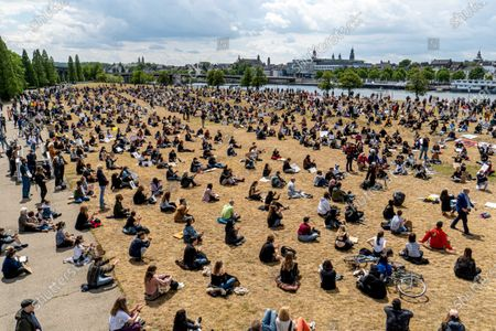 Aerial view of protesters taking part in a sit-in during an anti-racism demonstration at the De Griend park in Maastricht, The Netherlands, 07 June 2020. Organizers drew circles on the ground to ensure the minimum distance of 1.5 meters (feet) was kept to prevent infection with the SARS-CoV-2 coronavirus that causes the pandemic COVID-19 disease. The rally was held to condemn the killing of George Floyd, a 46-year-old African-American man who died on 25 May after being detained by police officers in Minneapolis (Minnesota), USA, and to express solidarity with the Black Lives Matter-led protests currently taking place throughout the US and in dozens of cities across the globe.