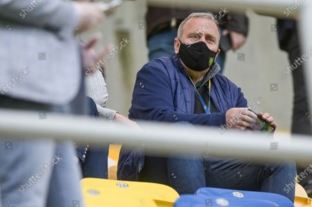 Stock Image of Politician, Grzegorz Schetyna seen on the tribune with a Slask Wroclaw protective mask during the Polish Ekstraklasa match between Arka Gdynia and Slask Wroclaw. (Final score; Arka Gdynia 2:1 Slask Wroclaw)