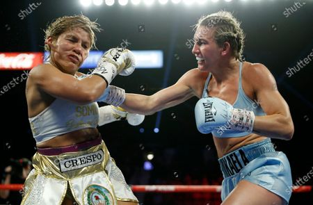 Mikaela Mayer, right, lands a right to Lizbeth Crespo in a boxing match in Las Vegas. Junior lightweight contender Mayer has tested positive for COVID-19 and has been pulled from the co-main event of Las Vegas' first major boxing card since the start of the coronavirus pandemic