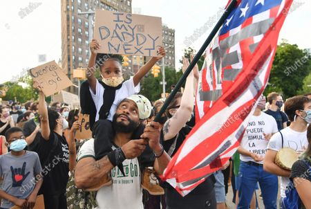 Demonstrators march at Grand Army Plaza in Brooklyn, New York to protest police brutality and the death of George Floyd,