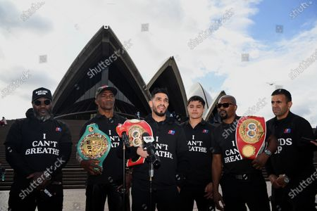 Professional boxer Billy Dib (C) speaks to the media during a Black Lives Matter protest at the Sydney Opera House in Sydney, Australia, 08 June 2020. Former world boxing champ Sakio Bika and other fighters have held a peaceful vigil in Sydney in solidarity with justice for George Floyd and the Black Lives Matter cause.
