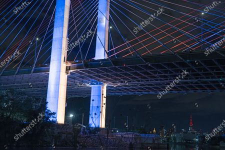 The Kosciuszko Bridge is seen illuminated in Blue and Gold in honor of New Yorkers' work to flatten the curve of the COVID-19 virus. Governor Andrew M. Cuomo today announced that landmarks across the state will be lit in blue and gold and will project 'New York Tough' in honor of New Yorkers' work to flatten the curve of the COVID-19 virus.
