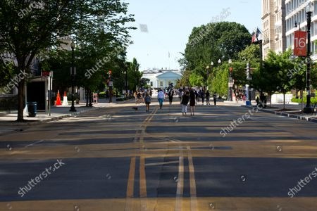 Black Lives Matter is seen painted on the street leading to the White House in Washington D.C., U.S.,. More than a week of demonstrations have occurred across the United States following the death of George Floyd in Minneapolis, Minnesota, while in police custody.