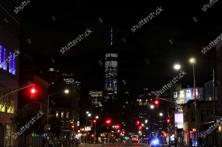 Photo taken on June 7, 2020 shows One World Trade Center lit in blue and gold in New York, the United States.   New York Governor Andrew M. Cuomo on Sunday announced landmarks across the state would be lit in blue and gold and will project 'New York Tough' in honor of New Yorkers' work to flatten the curve of the COVID-19 virus. The worst-hit New York City will enter phase one of reopening on Monday.