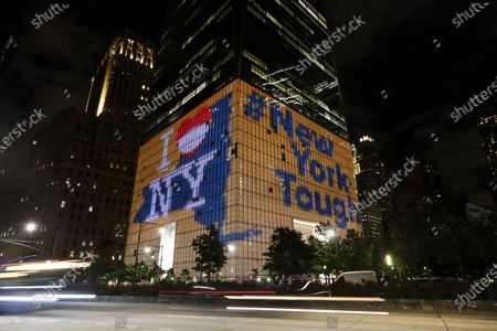 "Photo taken on June 7, 2020 shows One World Trade Center displaying the ""I love NY"" and ""New York Tough"" slogans in New York, the United States.   New York Governor Andrew M. Cuomo on Sunday announced landmarks across the state would be lit in blue and gold and will project 'New York Tough' in honor of New Yorkers' work to flatten the curve of the COVID-19 virus. The worst-hit New York City will enter phase one of reopening on Monday."