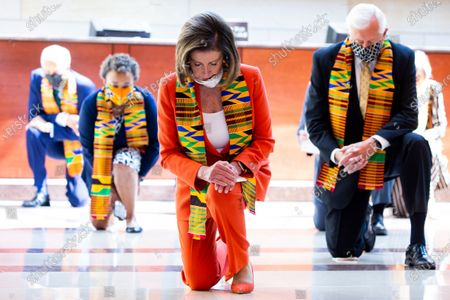 US Speaker of the House Nancy Pelosi (C) and Democratic lawmakers kneel while observing a moment of silence to honor George Floyd and victims of racial injustice, on Capitol Hill in Washington, DC, USA, 08 June 2020. The death of George Floyd while in police custody in Minneapolis has sparked global protests demanding policing reform.