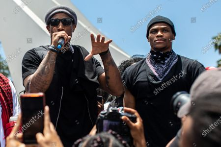 DeMar DeRozan, with the NBA's San Antonio Spurs, left and Russell Westbrook, with the NBA's Houston Rockets, speak to the crowd of a couple thousand protesters, at the conclusion of a Compton, CA, Peace Ride and walk with the Compton Cowboys, at Compton City Hall, on Sunday, June 7, 2020. (Jay L. Clendenin / Los Angeles Times)