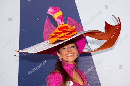Milliner Tracy Rose wears a large pink and orange silk hat and matching dress on Day One of Royal Ascot 2019 at Ascot Racecourse, Berkshire
