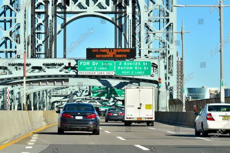 "Roadway sign on the Robert F. Kennedy Bridge stating ""NYC Phase 1 Reopening Today Anticipate Traffic"" as New York City enters Phase 1 of Covid-19 Reopening"
