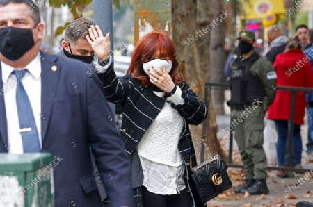 Vice President Cristina Fernandez waves to supporters as she enters court on the outskirts of Buenos Aires, Argentina, . The former president and former first lady is a witness in an investigation over alleged espionage during Mauricio Macri's presidency 2015-2019