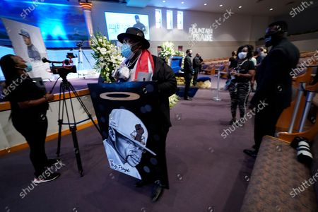 Brett White, of Dallas, moves near the casket of George Floyd during a public visitation for Floyd at the Fountain of Praise church, in Houston, Texas, USA, 08 June 2020. A bystander's video posted online on 25 May, appeared to show George Floyd, 46, pleading with arresting officers that he couldn't breathe as an officer knelt on his neck. The unarmed Black man later died in police custody and all four officers involved in the arrest have been charged and arrested.
