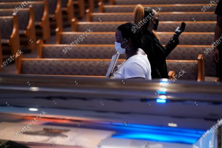 Stock Photo of Mourner Vicki Irving, passes the casket of George Floyd during a public visitation for Floyd at the Fountain of Praise church, in Houston, Texas, USA, 08 June 2020. A bystander's video posted online on 25 May, appeared to show George Floyd, 46, pleading with arresting officers that he couldn't breathe as an officer knelt on his neck. The unarmed Black man later died in police custody and all four officers involved in the arrest have been charged and arrested.
