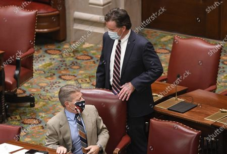 Stock Picture of New York Sate Sen. Patrick Gallivan, R-Elma, left, and Sen. John Flanagan, R-Smithtown, talk during a break in a Senate session at the state Capitol, in Albany, N.Y