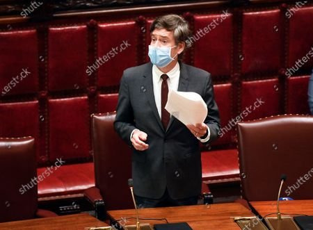 New York State Sen. Brad Hoylman, D-New York, reads a document during a Senate session at the state Capitol, in Albany, N.Y