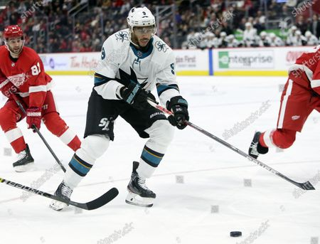 San Jose Sharks left wing Evander Kane (9) looks to pass the puck while being pursued by Detroit Red Wings center Frans Nielsen (81), of Denmark, during the first period of an NHL hockey game in Detroit. Seven current or former black NHL players have formed the Hockey Diversity Alliance to fight racism and intolerance in the sport. Akim Aliu and San Jose's Kane will lead the group, which also includes Trevor Daley, Matt Dumba, Wayne Simmonds, Chris Stewart and recently retired Joel Ward