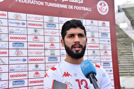 Tunisian player Ferjani sassi speaks to the press after training at the Elmanzeh stadium after three months of inactivity due to the coronavirus pandemic.