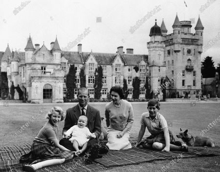 Britain's Queen Elizabeth II, Prince Philip and their children, Prince Charles, right, Princess Anne and Prince Andrew, pose for a photo on the lawn of Balmoral Castle, in Scotland