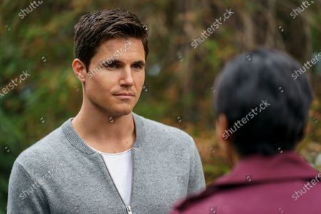 Stock Photo of Robbie Amell as Nathan Brown and Andy Allo as Nora Antony