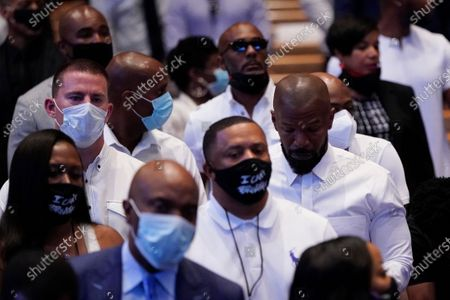 Actor Channing Tatum, back left, sits with actor Jamie Foxx during a funeral service for George Floyd at The Fountain of Praise church, in Houston