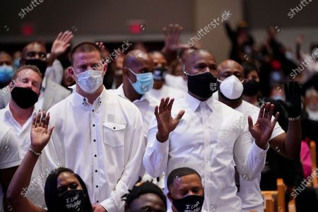 Actor Channing Tatum, left, stands with actor Jamie Foxx during a funeral service for George Floyd at The Fountain of Praise church, in Houston