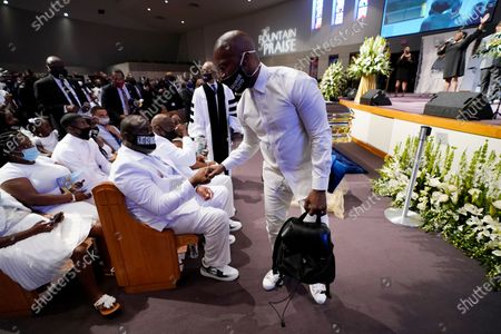 Actory Jamie Foxx, right, speaks with Rodney Floyd during the funeral service for George Floyd at The Fountain of Praise church, in Houston