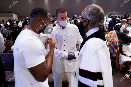 Actor Channing Tatum, center, speaks with the Rev. Al Sharpton, right, after the funeral service for George Floyd at The Fountain of Praise church, in Houston