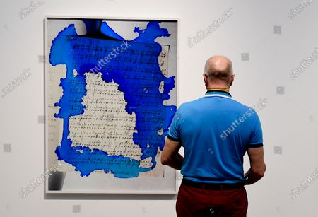 Stock Picture of A visitor admires the artwork 'Code / Blue' by Viviane Sassen during a press presentation of the exhibition 'Time Present - Photography from the Deutsche Bank Collection' in Berlin, Germany, 09 June 2020. The exhibit offers an overview of four decades of the collection's history. More than 60 works by prominent artists are displayed.