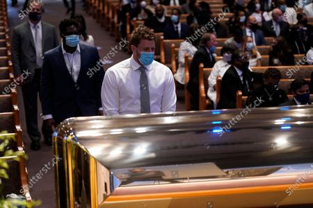 Houston Texans NFL player J. J. Watt, pauses by the casket during a funeral service for George Floyd at the Fountain of Praise church, Houston, Texas, USA, 09 June 2020. A bystander's video posted online on 25 May, appeared to show George Floyd, 46, pleading with arresting officers that he couldn't breathe as an officer knelt on his neck. The unarmed Black man later died in police custody and all four officers involved in the arrest have been charged and arrested.